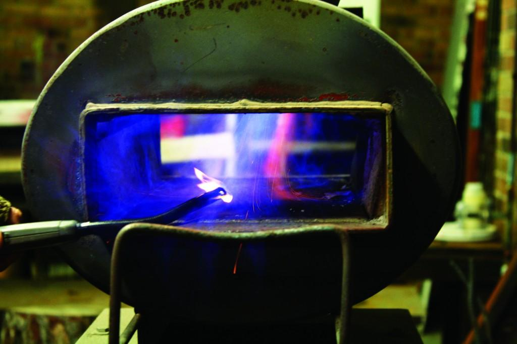 A lighter sets off the flame to begin heating up the forge.