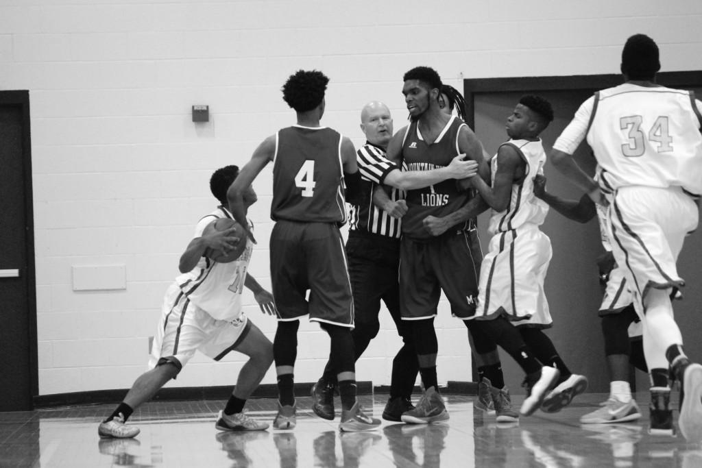 Photos by Brigitte Zumaya |Tension rises as Mountain View Lion Anthony Walker Jr. (#1) and Brookhaven Bear Blake Ervin (#10) are separated by the referee and teammates during a heated moment.