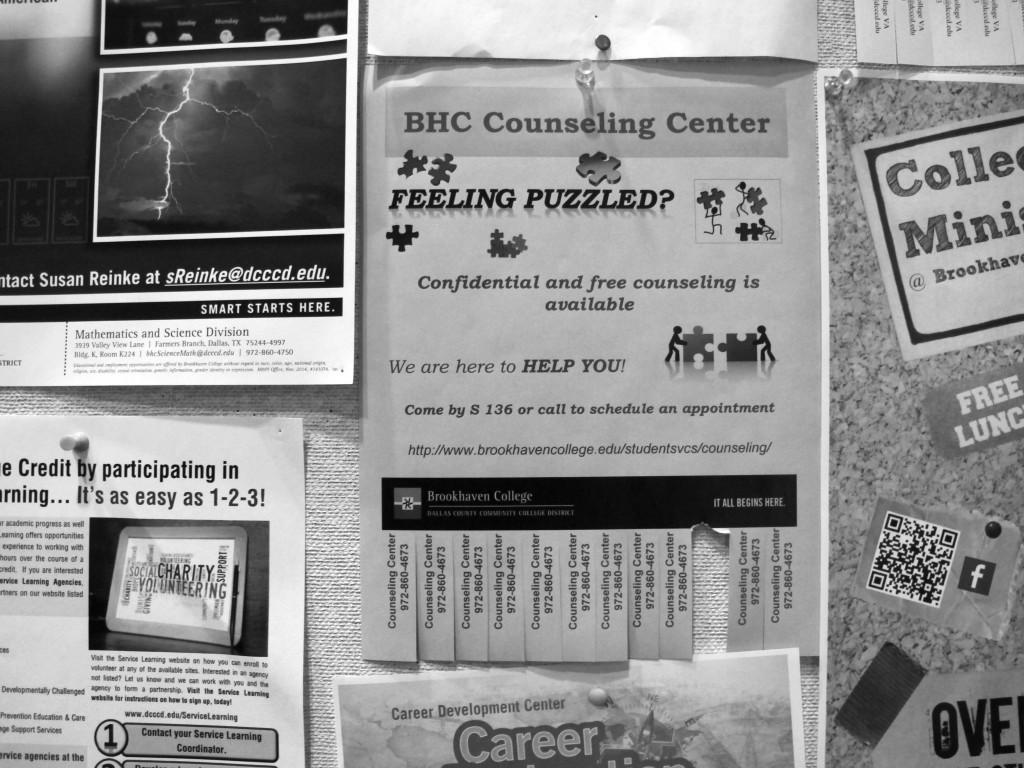 Photo by Nicholas Bostick | Flyers promoting the counseling center services are pinned on boards across campus.