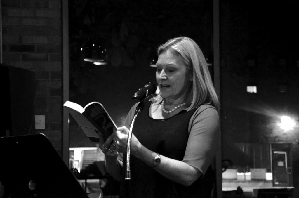 "Photo by Travis Baugh | Carney's publisher, Kaylie Jones, reads aloud from her latest book, ""The Anger Meridian."""