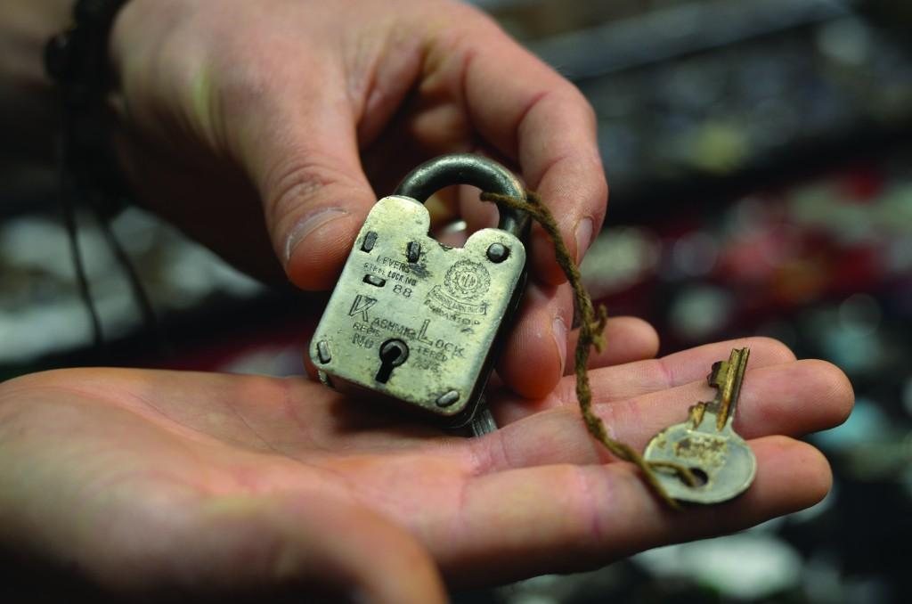 A vendor shows his 80-year-old padlock found in India
