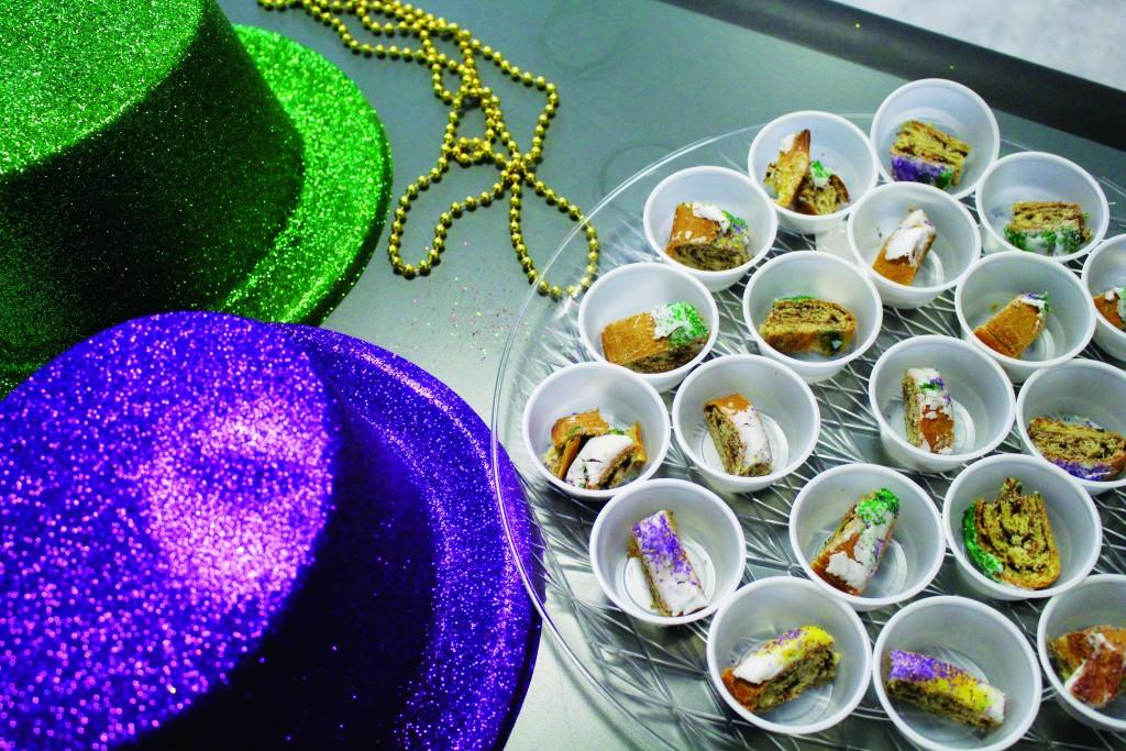 Photos by Brigitte Zumaya | 1. Traditional Mardis Gras decorations and sweet king cake attract attendees