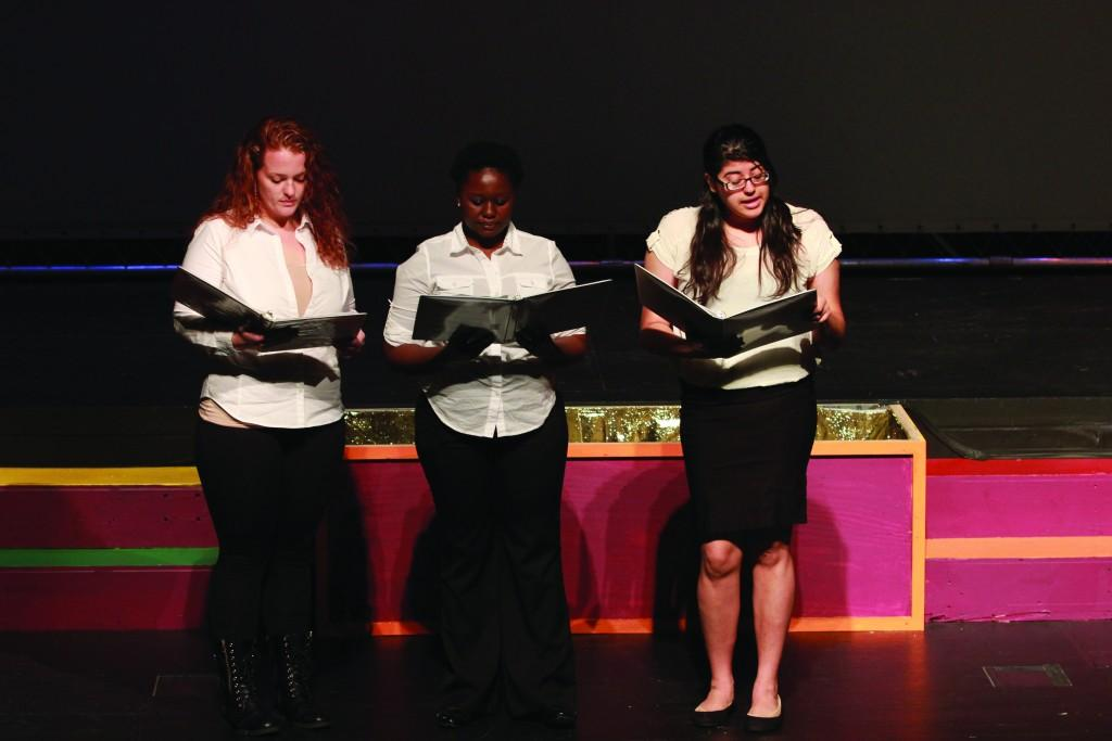 "Photo by Claudia Valerio | Abbey Adenuga, Ariel Goodwin and Honoria Delgado read Sterling Brown's 1931 poem, ""Strong Men."""