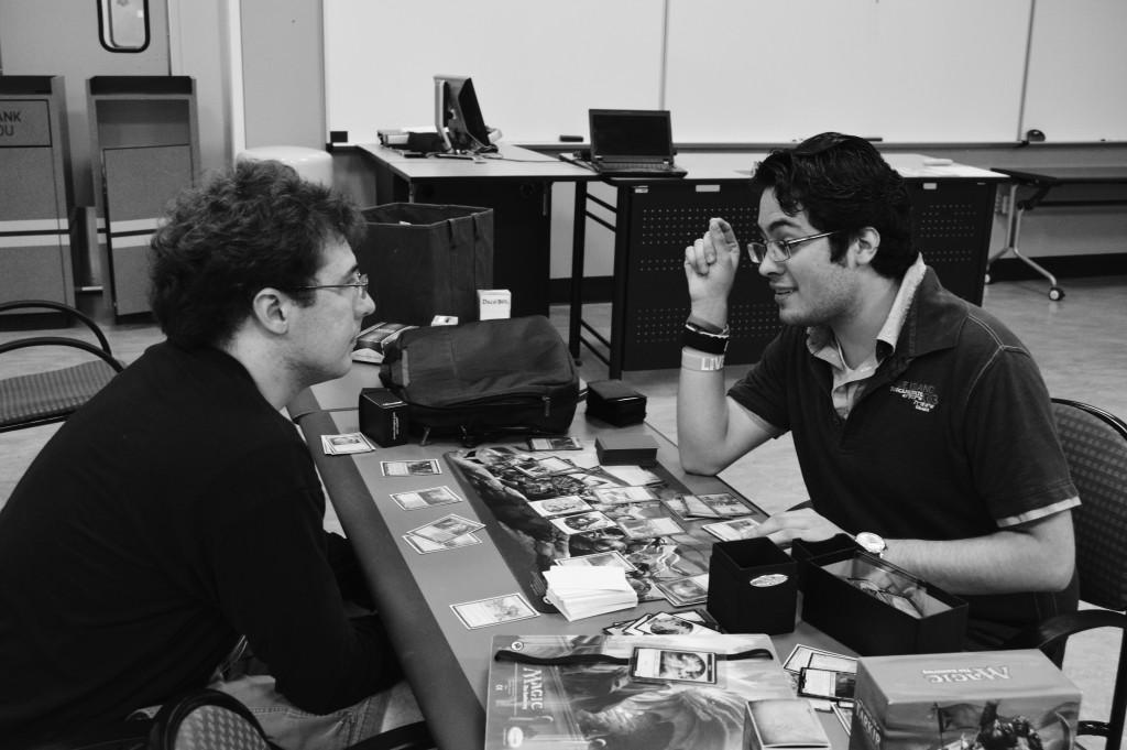 Photo by Marvin Montesinos | Staff Writer     Game club president Ricardo Flores Ruiz (right) teaches Ryan Bogan (left) how to play Magic: The Gathering.