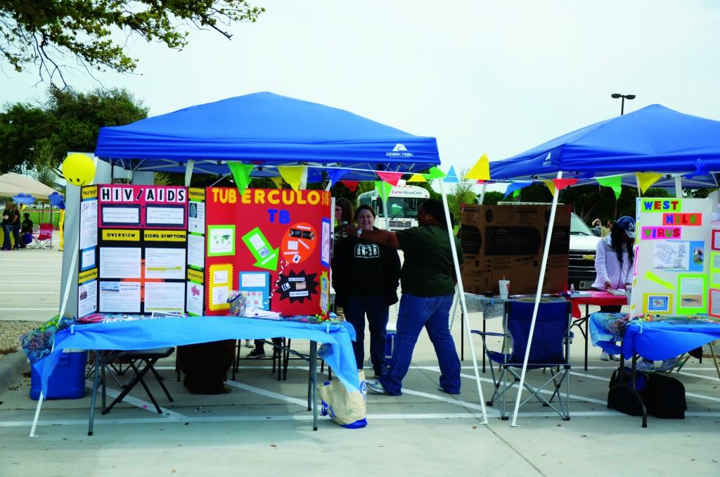 Several booths are set up to raise awareness of weather and health preparedness.