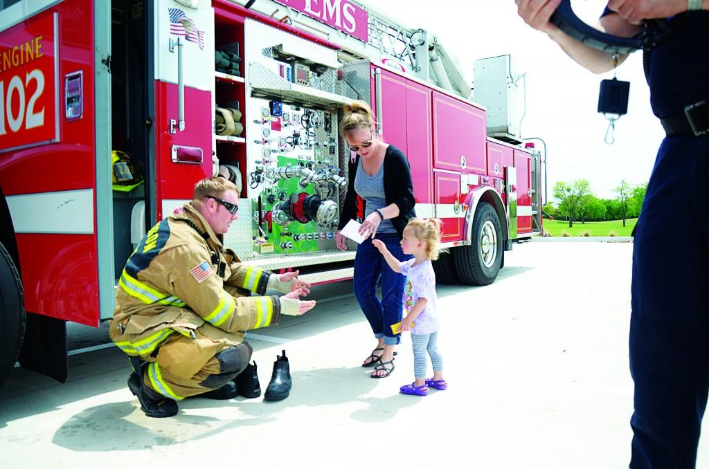 Photo by Travis Baugh | Courier Firefighter Cash Fortune interacts with event attendees.