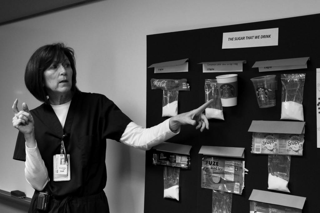 "Photos by Claudia Valerio | Courier  Brookhaven College Nurse Mildred Kelley talks about ""the sugar that we drink."""