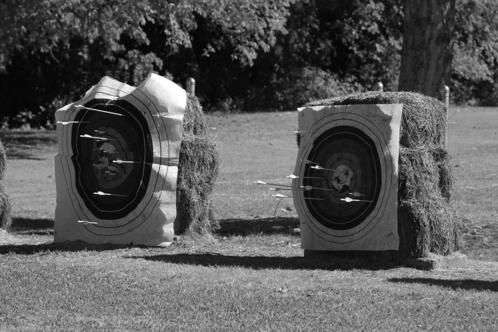 Students practice shooting at designated targets, and landing arrows on a bullseye earns them points.