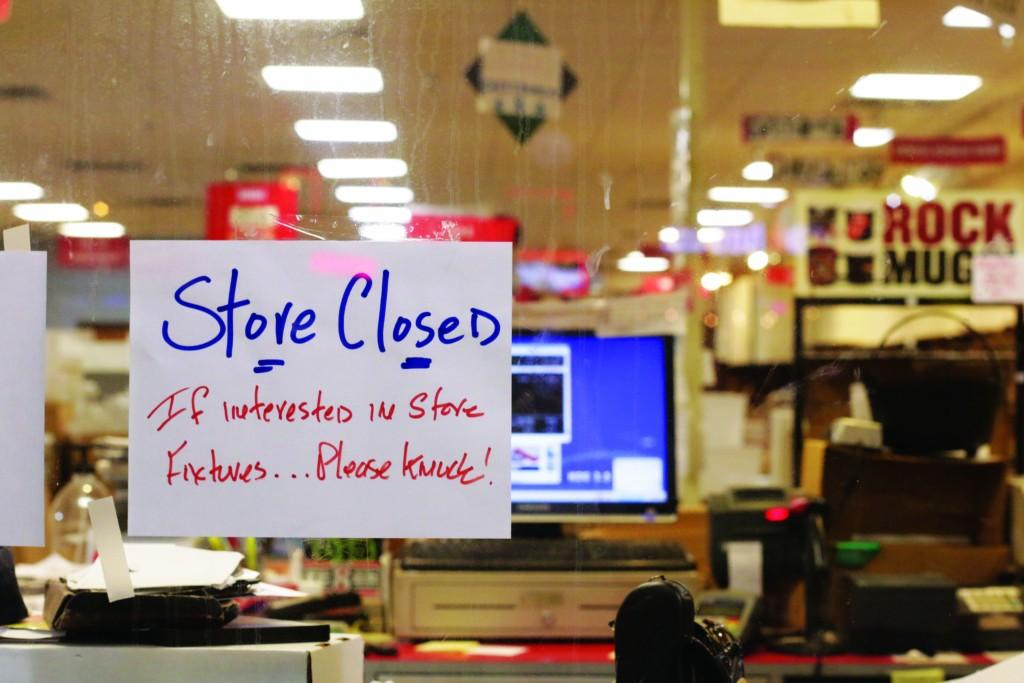 All Photos by Evan Henry | A sign hangs on the window of CD Source, alerting passersby of the store's closing.