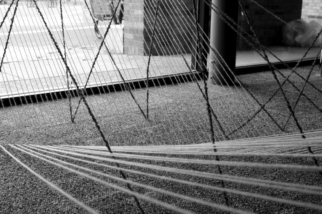 Photos by Evan Henry| Courier Colored yarn shapes itself around a stairwell to match the jazzy tempos of The Bad Plus.