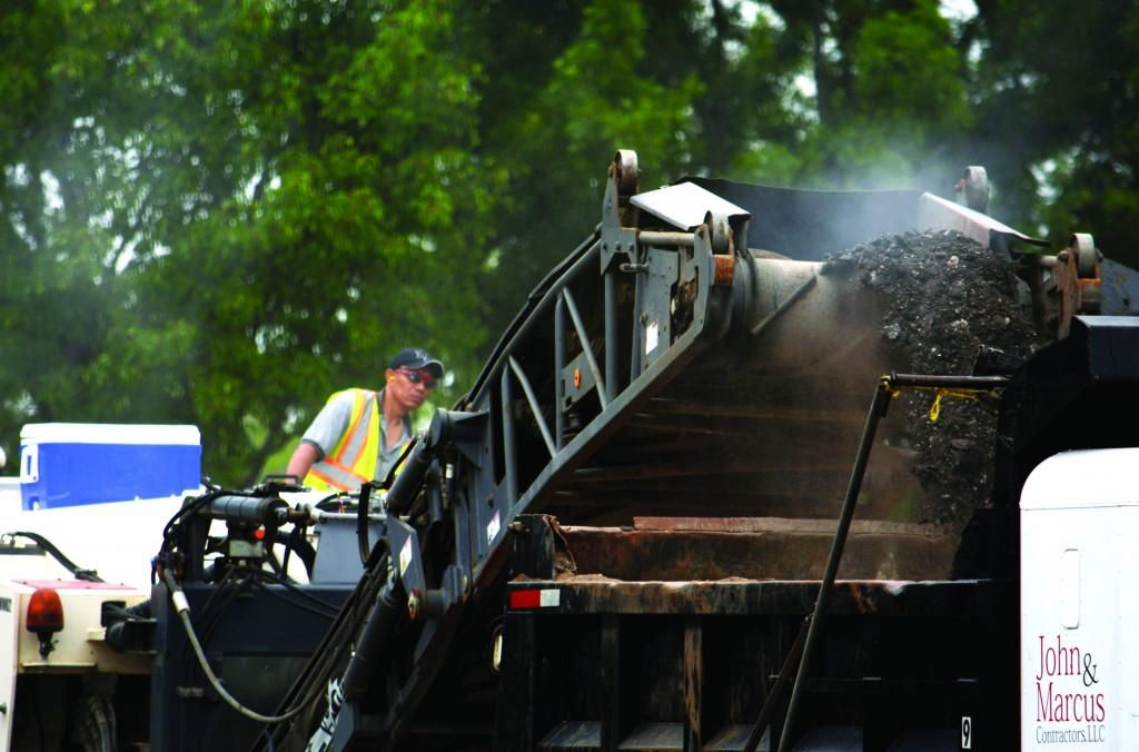 The cold milling machine crushes the asphalt, which will be recycled as an aggregate new pavement of the parking lot. Milling the old asphalt will reduce the impact that resurfacing has on the environment