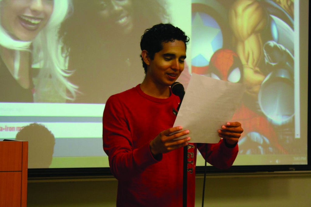 Student Jamie Goicoechn reads aloud an original story created from comic prompts provided to attendees.