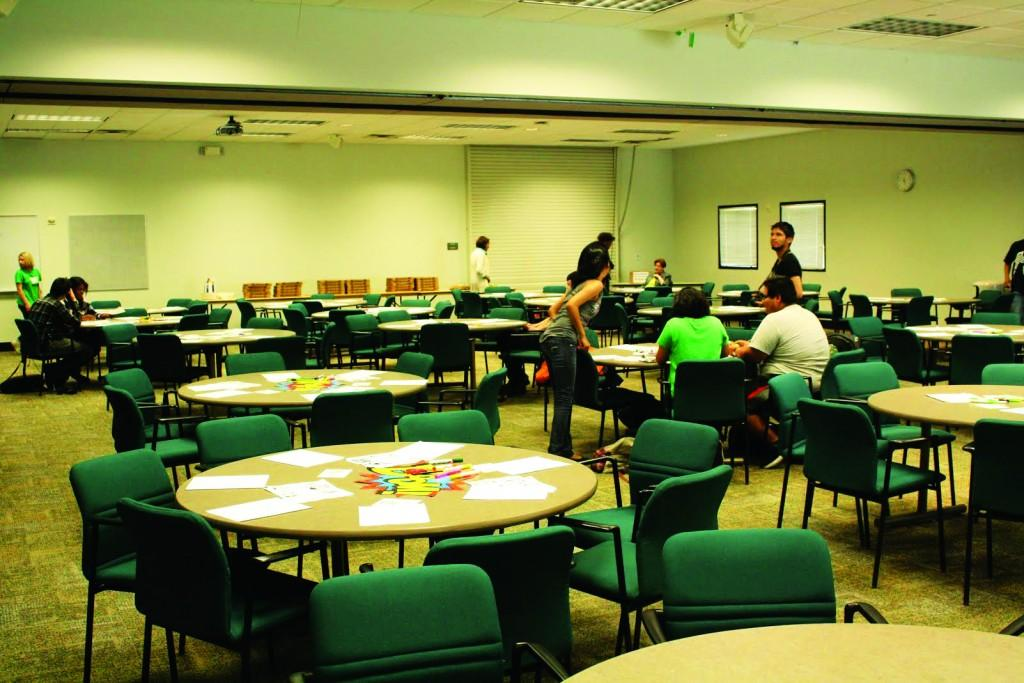 Students begin to show up for the event and take seats at tables splayed with art supplies.