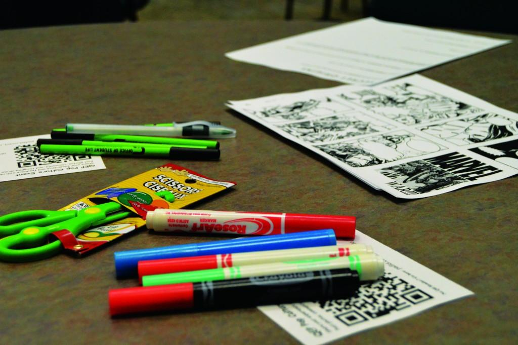 Photo by Marvin Montesinos | Courier Markers, scissors and other craft materials cover tabletops.