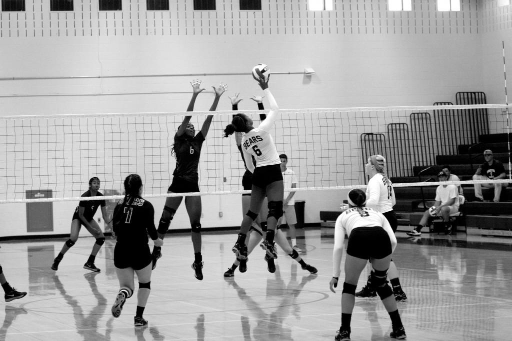 Outside hitter Kelsey Rogers (#6) leaps high to spike the ball.