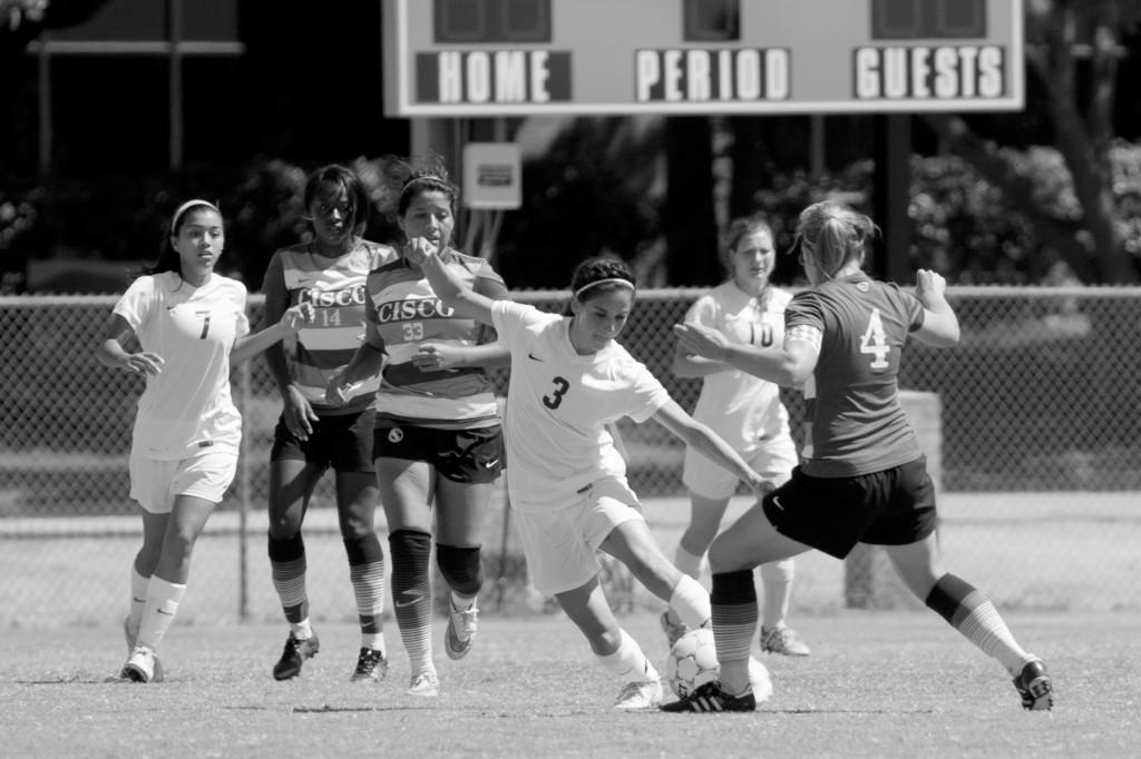 All photos by Ravin Lee | Brookhaven Bears Midfielder Claudia Aguilar (#3) dribbles the ball past the Cisco Wranglers defense.