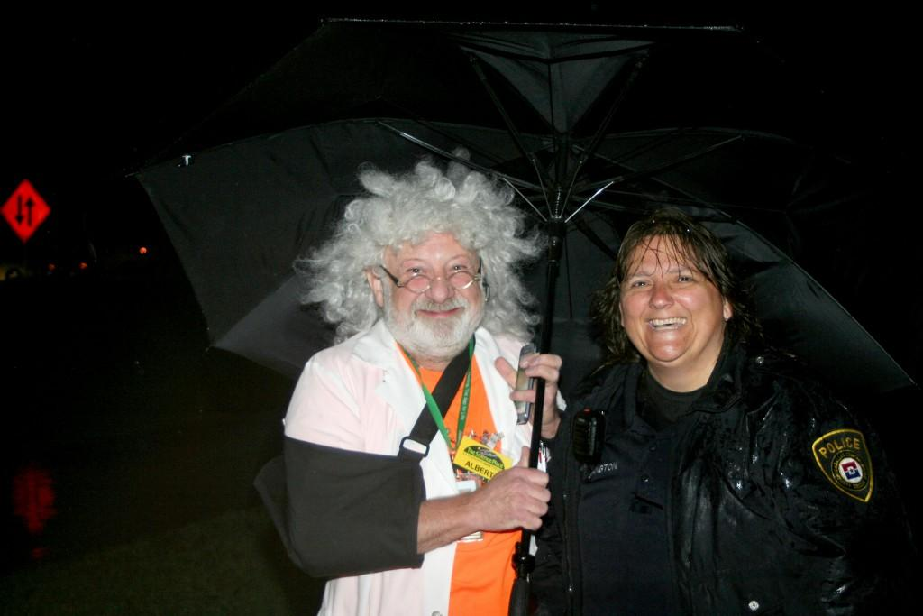 Photos by Andrew Zavala Chaz Hafey, Brookhaven College astronomy and physics lab coordinator, dressed as Einstein, and Vikki Ethington keep high spirits as they shelter from the rain.