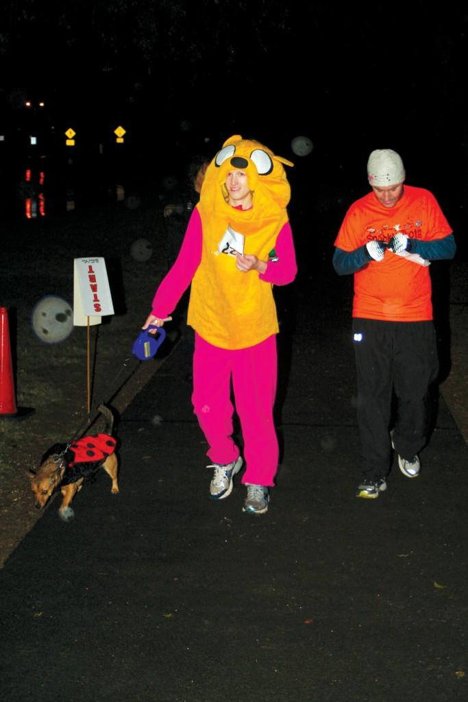 "Sarah Epstein, dressed as Jake from ""Adventure Time,"" brought her dog, dressed as a lady bug, to run with her."