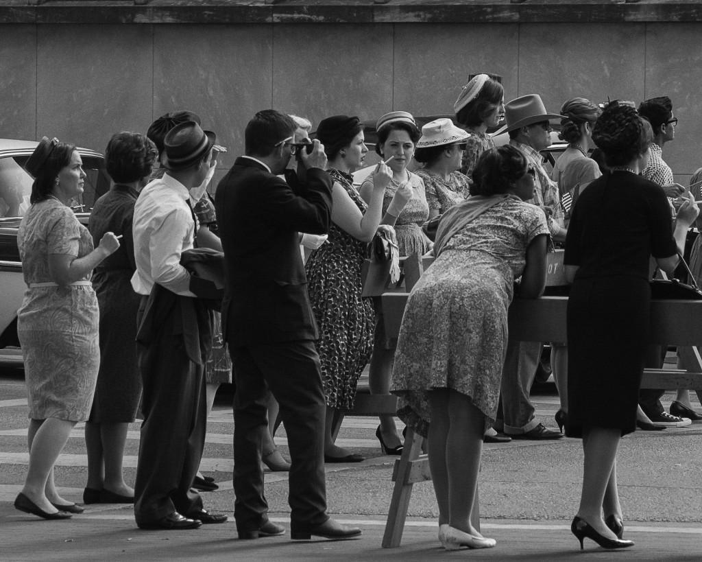 Photos by Michael Dunlap   Onlookers gather awaiting presidential motorcade carrying President John F. Kennedy.