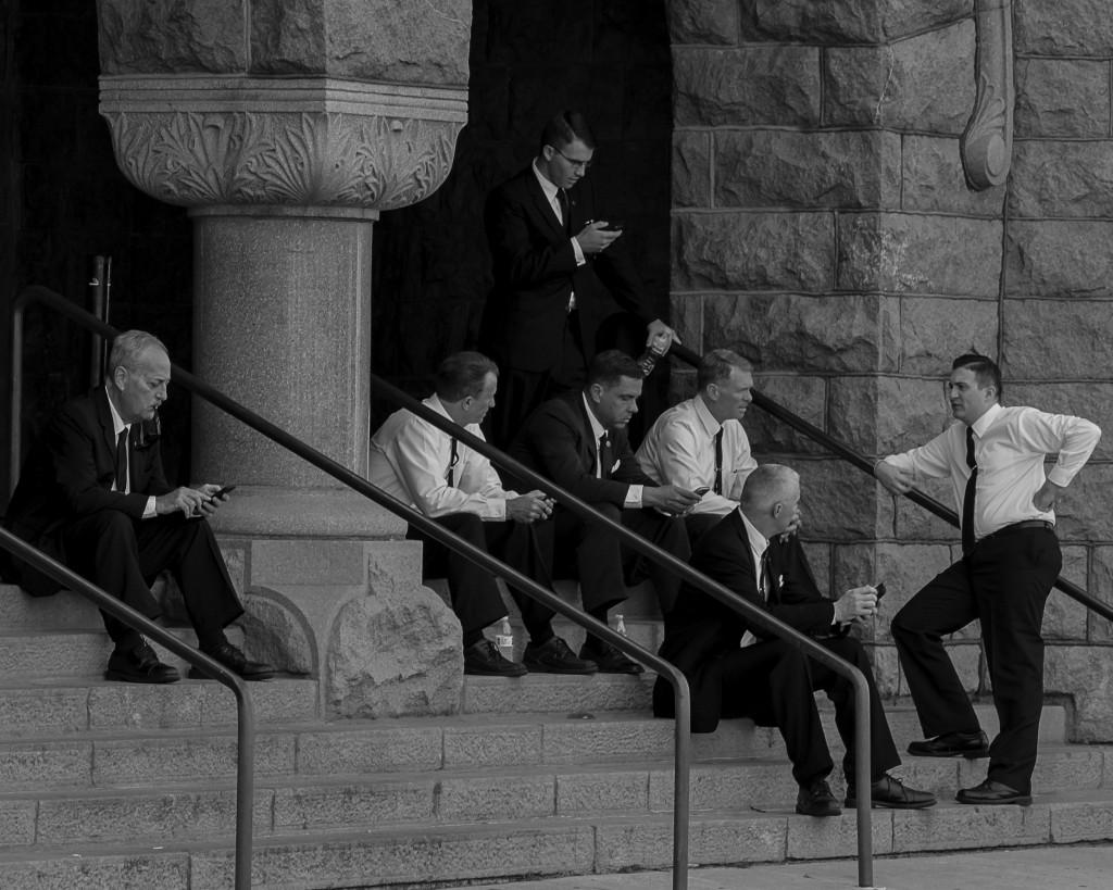 Secret Service cast takes a break from filming on the steps of the Dallas County Courthouse.