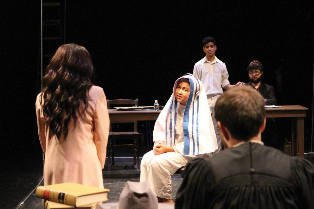 "Photo by Brigitte Zumaya | Jayden Russell, a student playing Mother Theresa, is being questioned by Dayna Fries , a student playing a lawyer, in ""The Last Days of Judas Iscariot"" in a dress rehearsal Dec.1."
