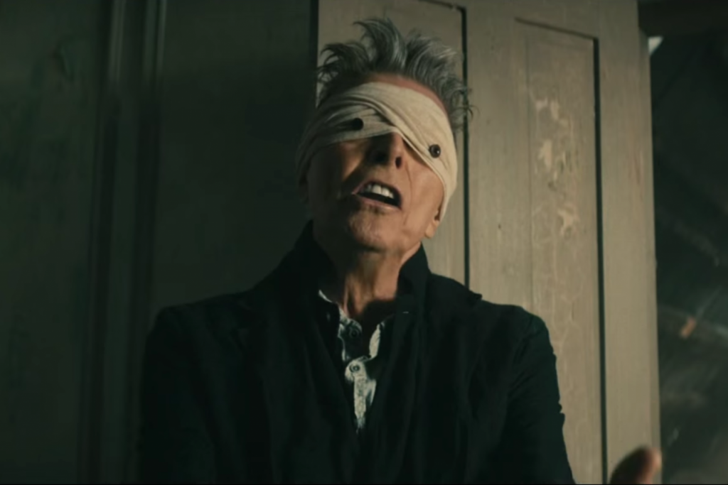 "Still from David Bowie's ""Lazarus"" music video."