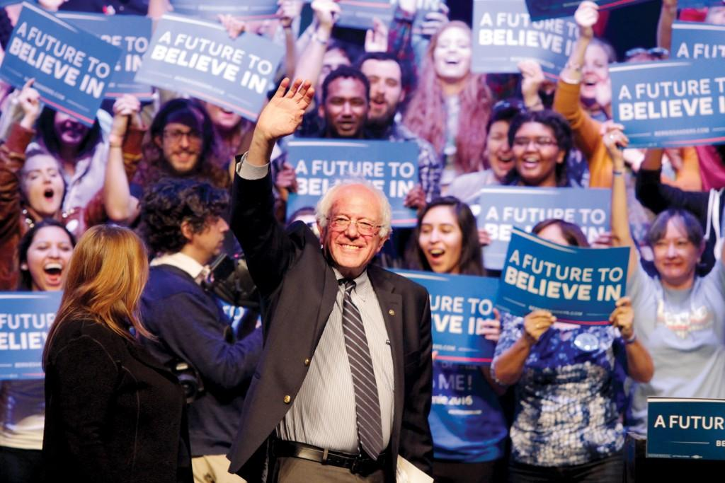 Photo by Ravin René |Bernie Sanders, Vermont senator and Democratic presidential candidate, waves at a supportive crowd of more than 7,000, Feb. 27, at the Verizon Theatre in Grand Prairie.