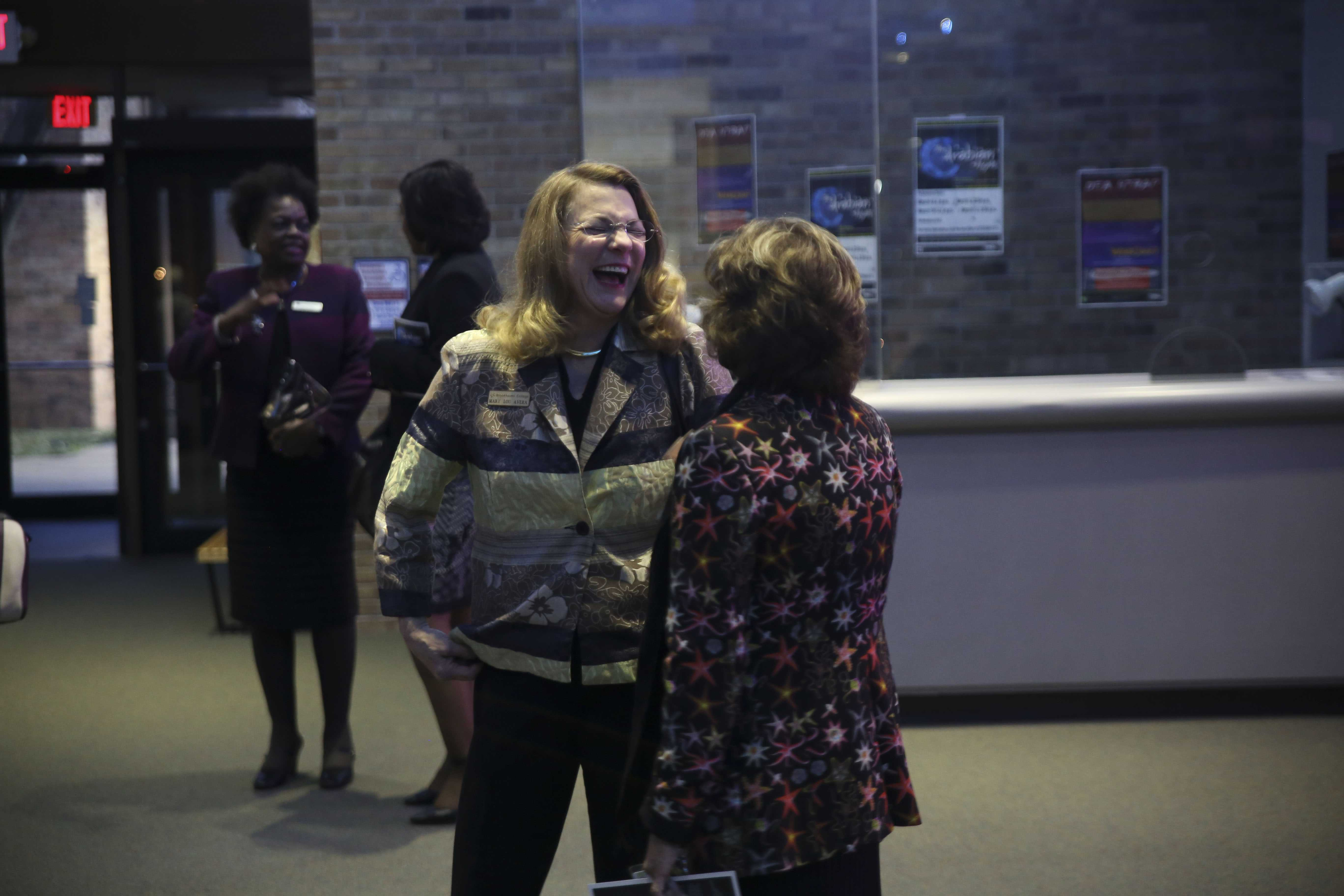 Photos by Aina Abdul-Qader | Mary Lou Avera, Brookhaven College faculty member, enjoys conversation at the alumni event.