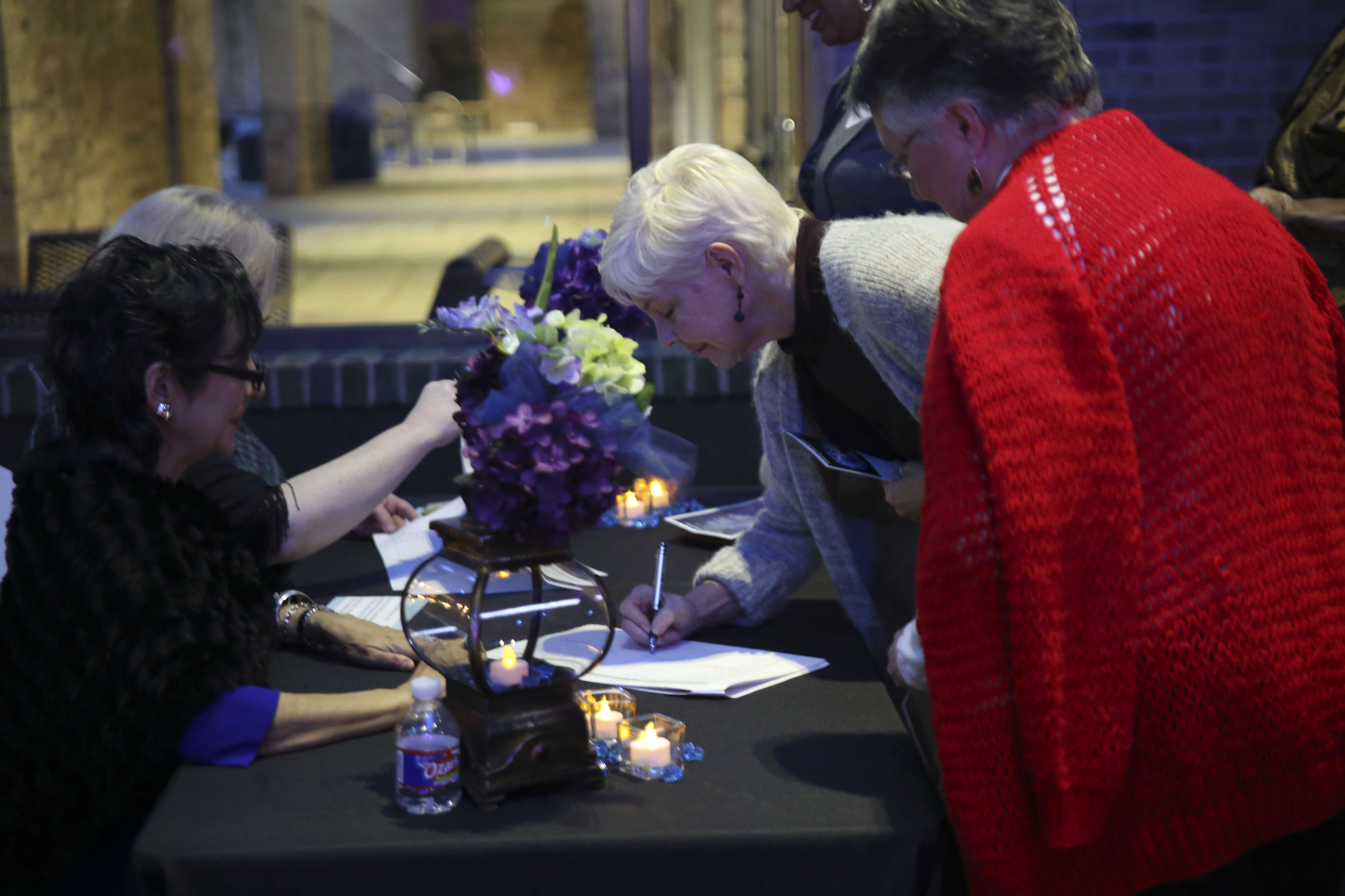 Guests sign in at the beginning of the event
