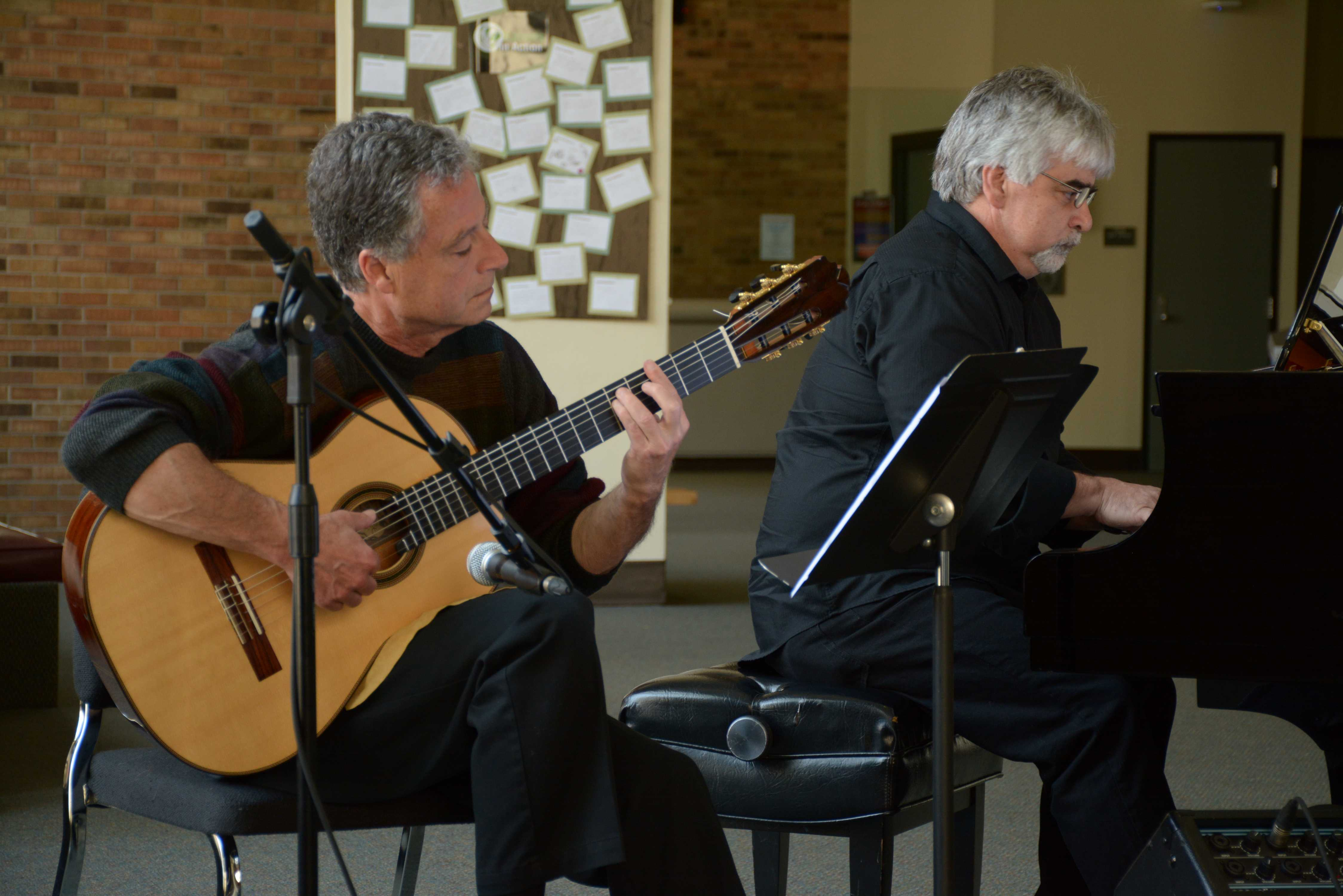 Photo by Jubenal Aguilar |Rodger Bennett and David Perez-Guerra play a song by Beethoven during the first coffee concert of the semester in the Performance Hall lobby March 23.