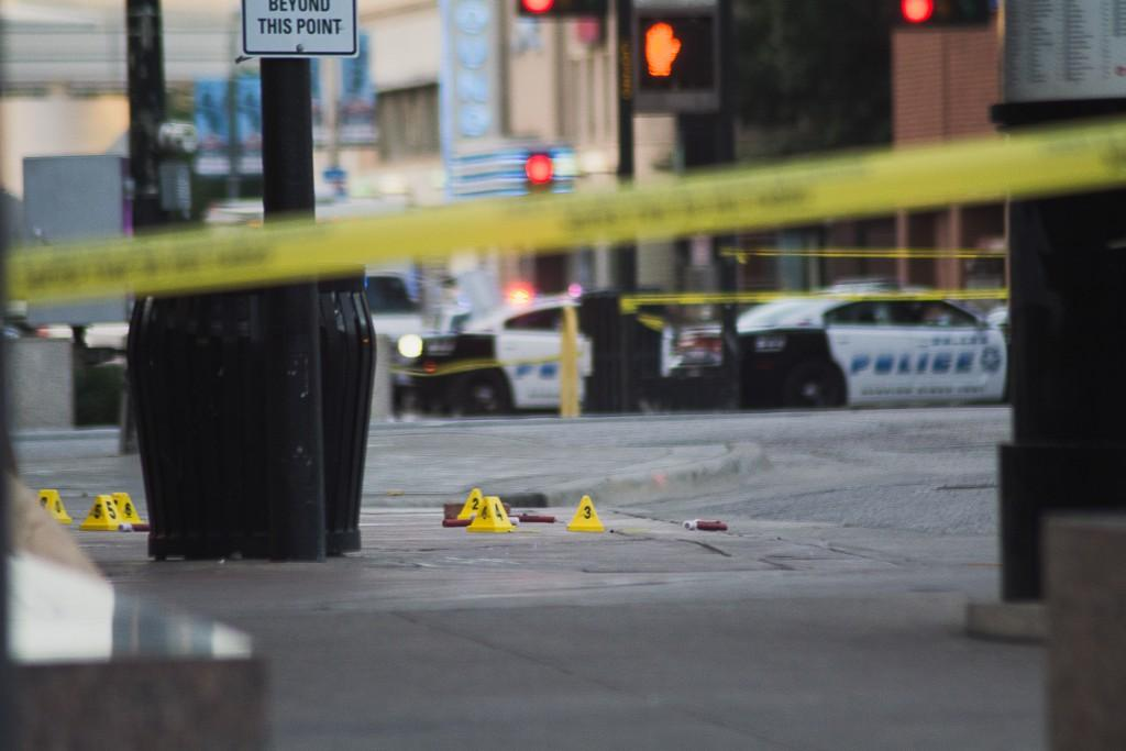 Photo by Michael Dunlap The Dallas Police Department set cones to mark the evidence of the crime that took place July 7.