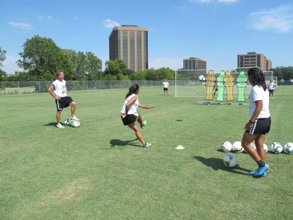 Photos by Juan Betancourt Jim Elder, Brookhaven College soccer coach, watches as one of his players kicks a ball toward a Soccer Wall.