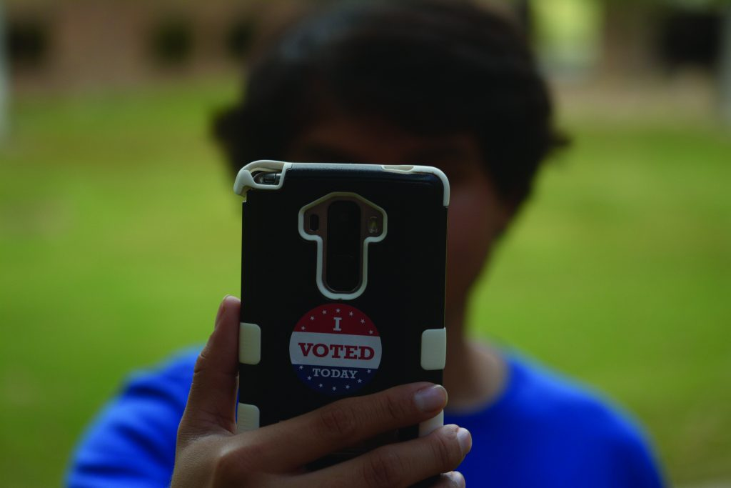 Photo illustration by Jubenal Aguilar Some states have outlawed voters taking selfies or other photos in and around polling places.