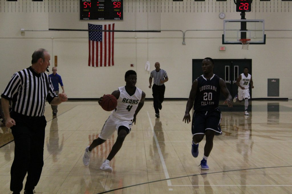 Jeremy Ford (#4) beelines for the basket as Louisiana struggles to keep pace.