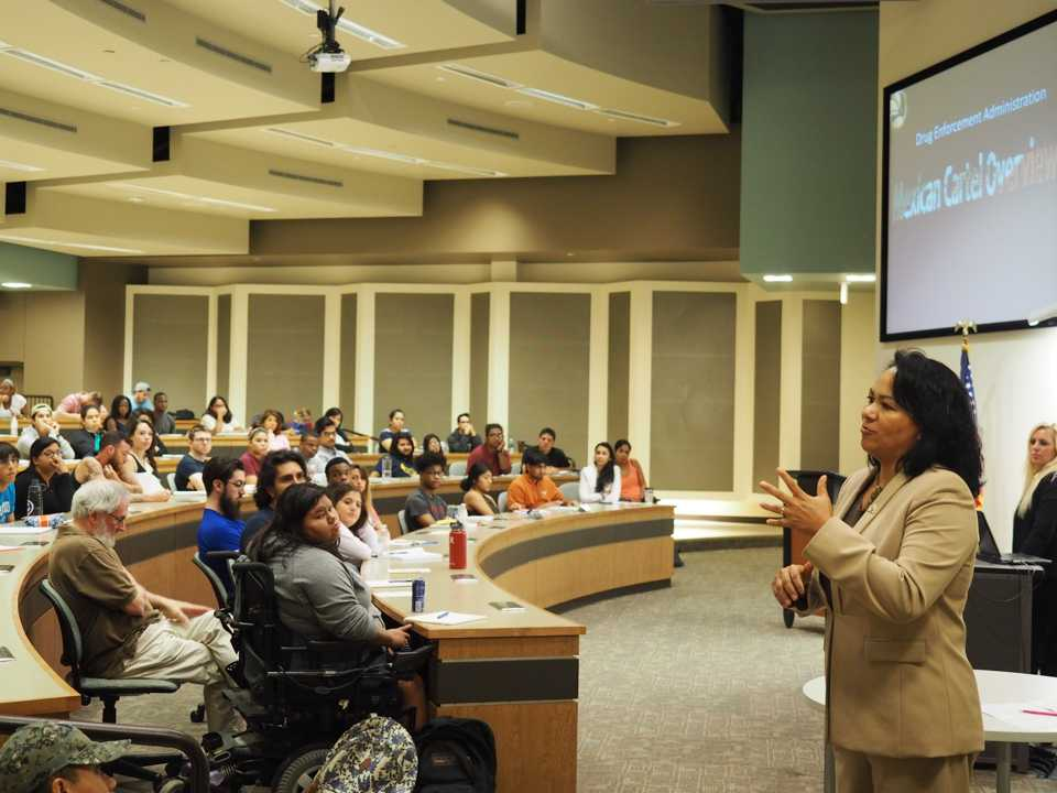Photo by Jubenal Aguilar Angelica Gurrola, a Drug Enforcement Administration special agent, talks to students, staff and faculty about local drug rings that use the homeless  to obtain prescription medications with the aid of accomplice doctors.