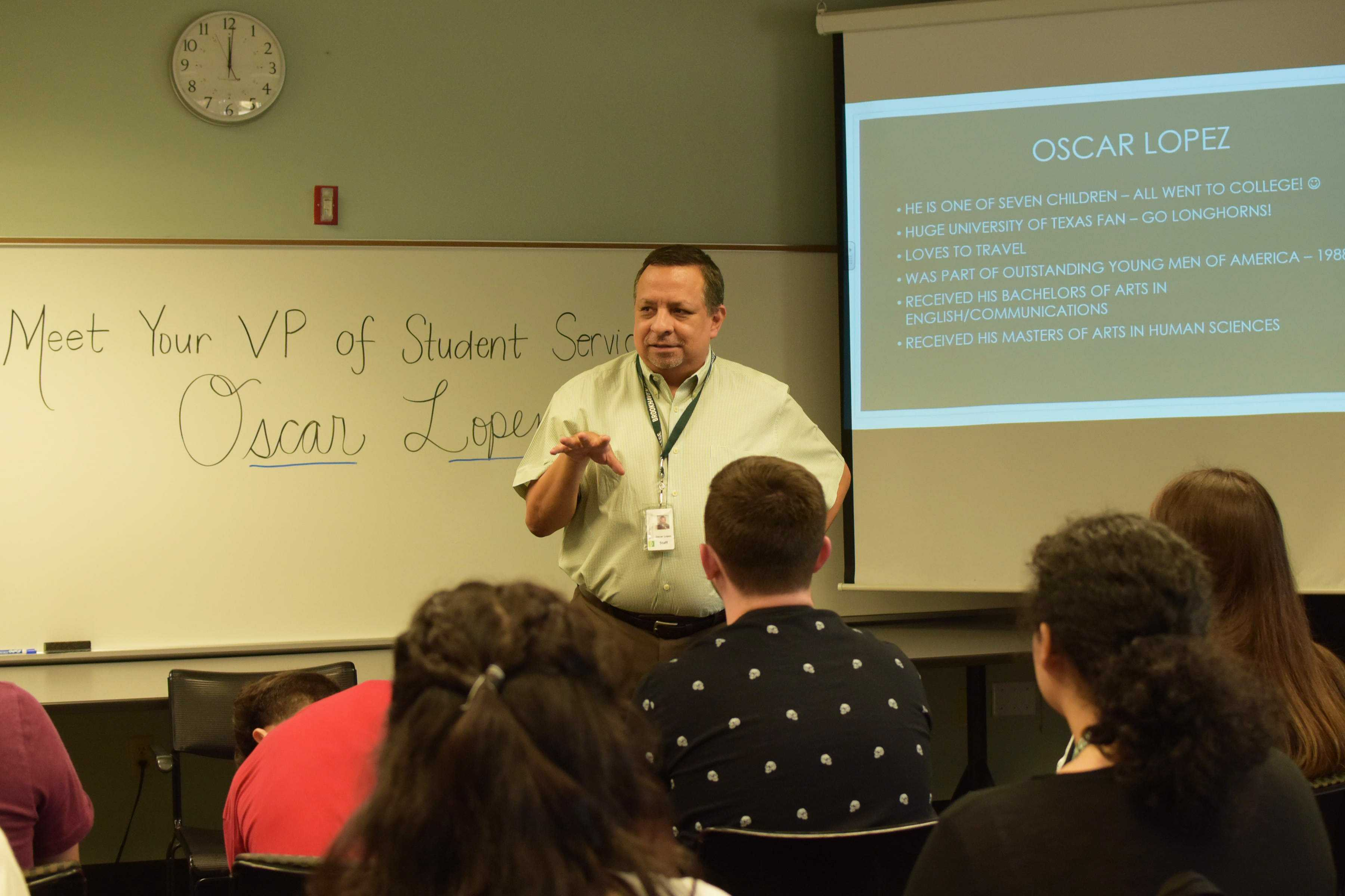 Photos by Brandon Donner | Oscar Lopez, vice president of student services, explains his role to students Aug. 29 during the Pizza with the VP event.