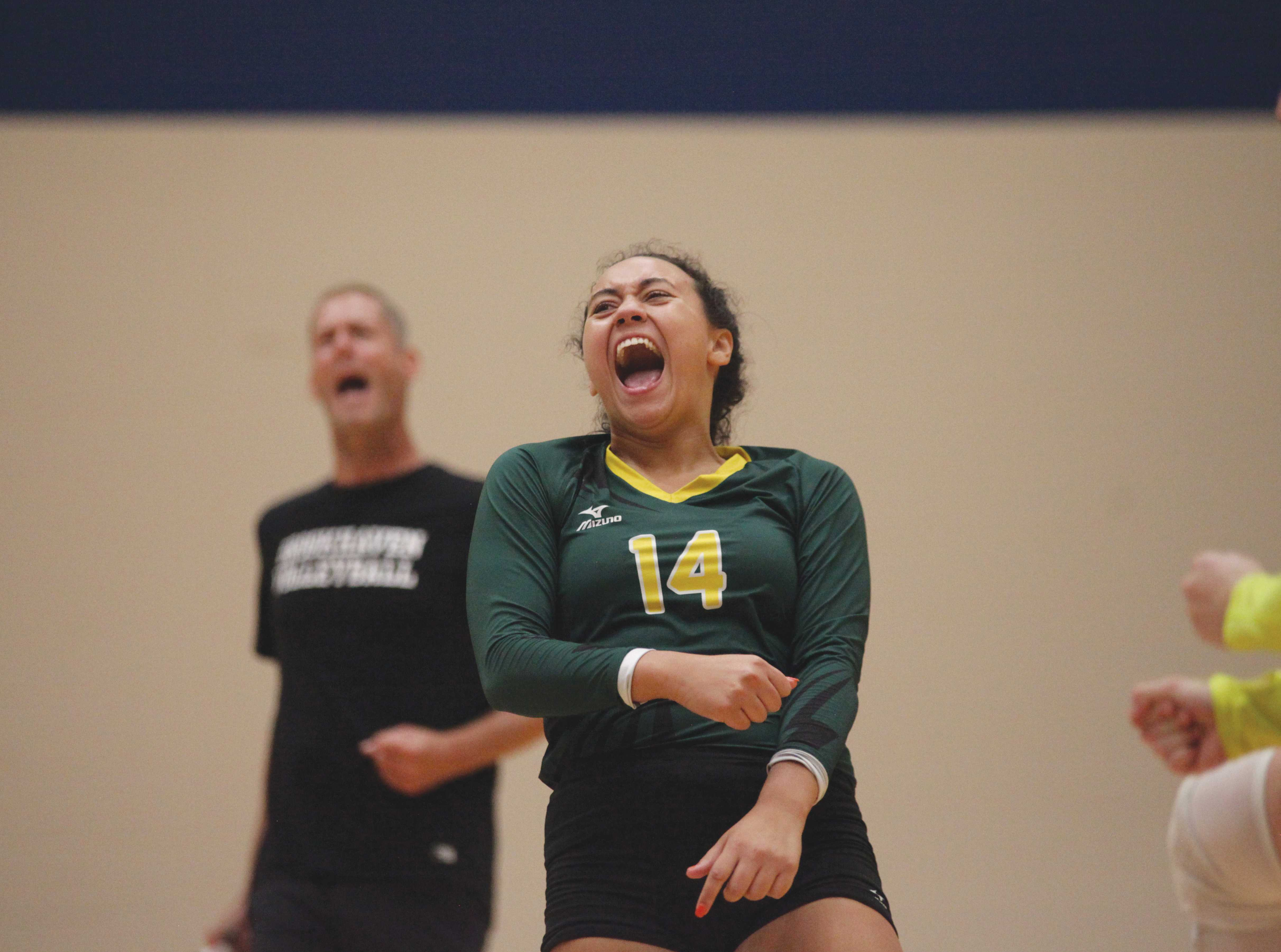 <strong>Photos by Malen Blackmon |</strong>Lady Bears setter Morgan Frisby (#14) celebrates after the winning the point of the match.