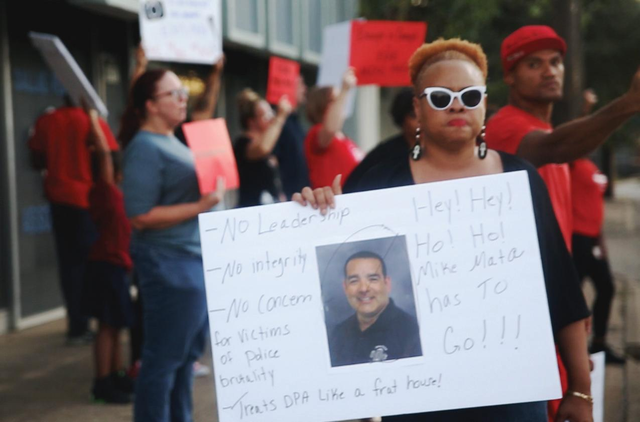Photo by Jacob Vaughn |  Pamela L. Grayson, a local activist, protests outside the Dallas Police Association building Sept. 27, calling for its president's resignation.