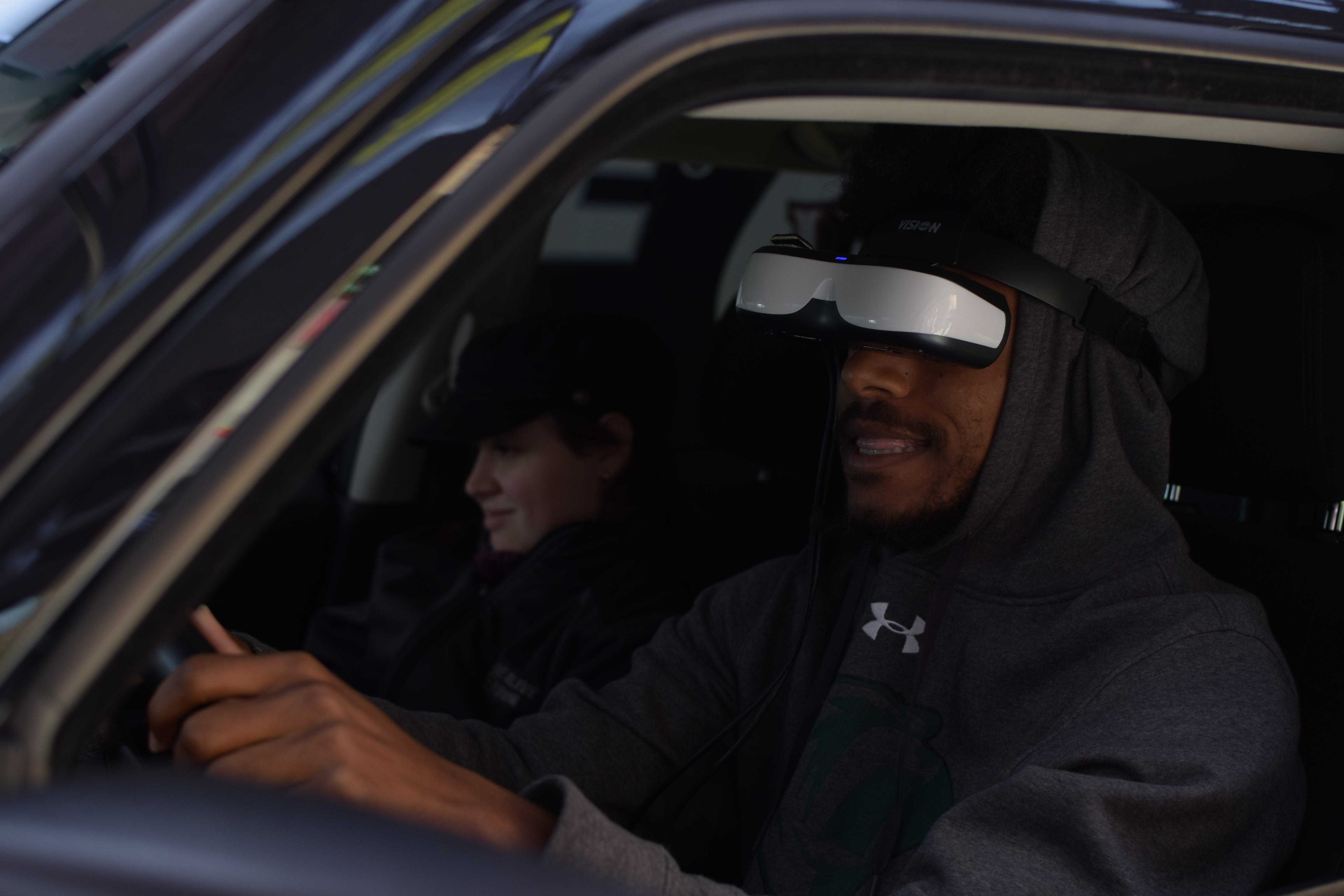 Photo by Brandon Donner |  Student Osaze Muhammad tests the intoxicated driver simulator Oct. 16 during the National Collegiate Alcohol Awareness Arrive Alive tour's stop at Brookhaven College.