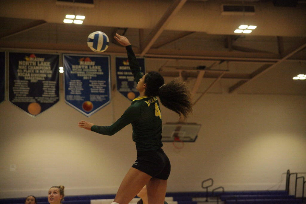 <strong>Photo by Malen Blackmon |</strong> Bears outside hitter Yasmin Miller (#4) spikes the ball.