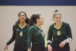 <strong>Photo by Malen Blackmon |</strong> From left: Lady Bears outside hitter Yasmin Miller (#4), setter Morgan Frisby (#14) and outside hitter Faith Fetzer (#6) celebrate after a point earlier this season against North Lake College.