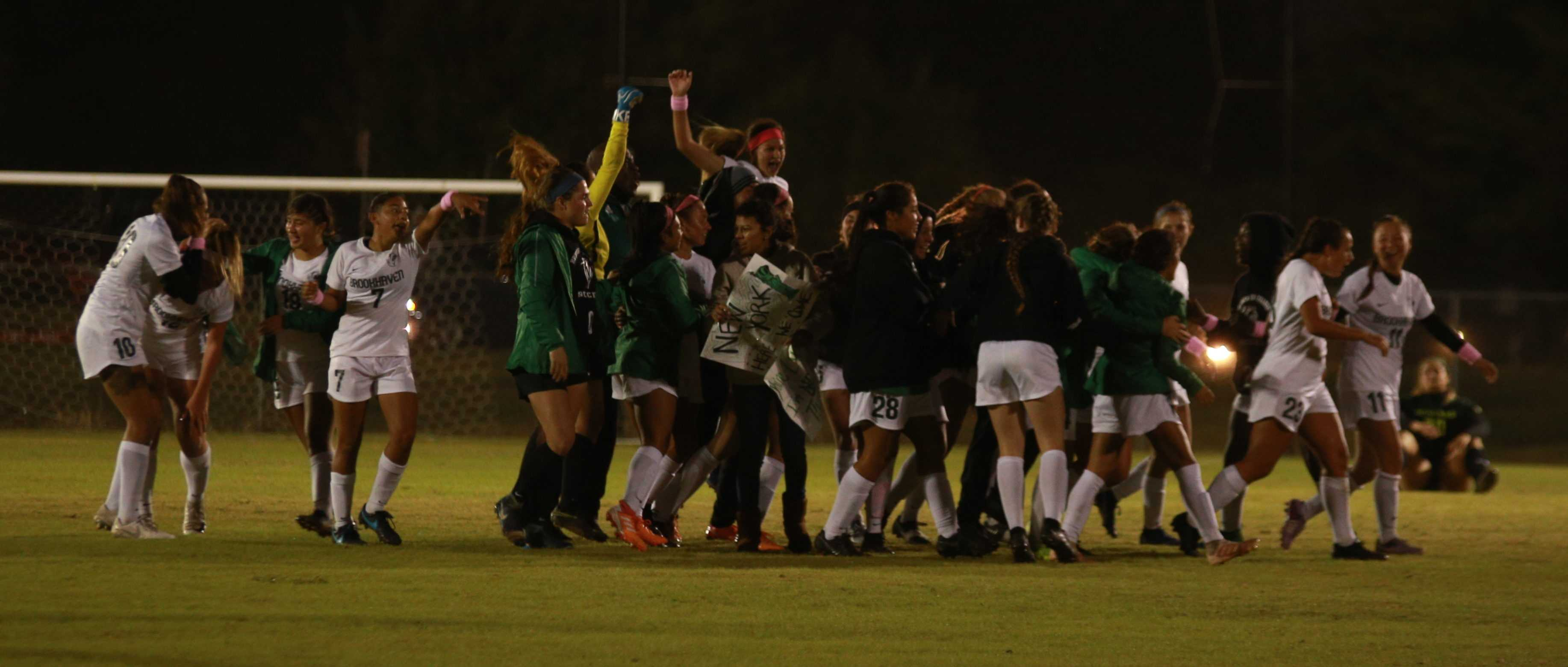 <strong>Photos by Brandon Donner |</strong> The Lady Bears celebrate their win against Richland College in the NJCAA Region V Championship game Oct. 28; Lady Bears forward Taylor Brown (#17) attempts a shot.