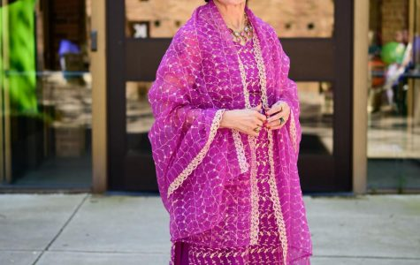 Sheri Van Court, English for speakers of other languages professor, shows of her Iranian outfit during the spring 2019 International Day fest.