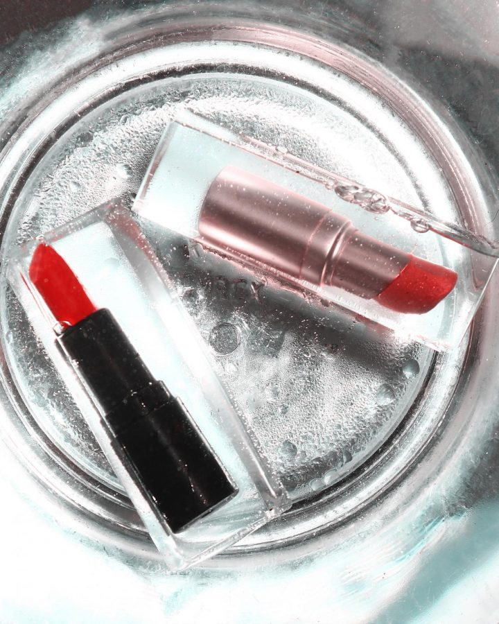 Two lipsticks in water