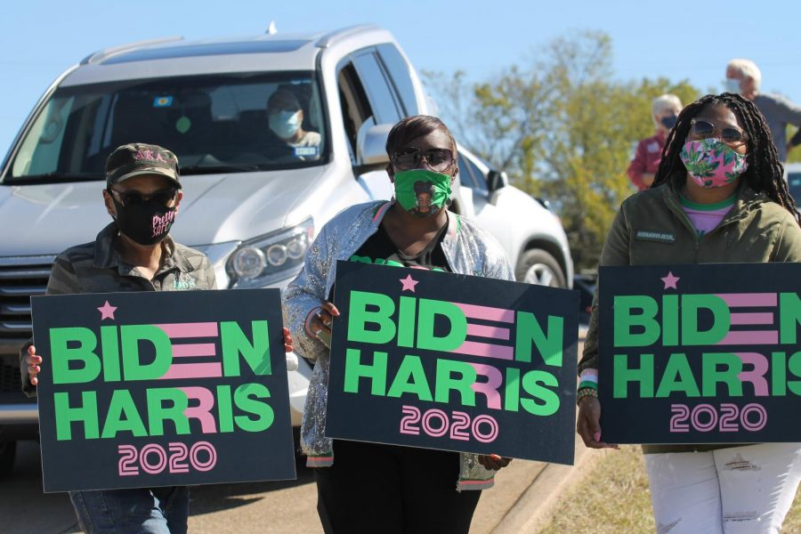 Biden and Harris fans show their support with signs during Democratic vice presidential nominee Kamala Harris' Oct. 30 campaign stop in Fort Worth.