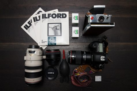 photo of camera products - lens, camera, photo paper and film