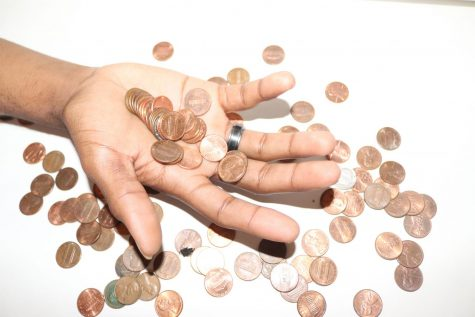 Photo of hand holding pennies