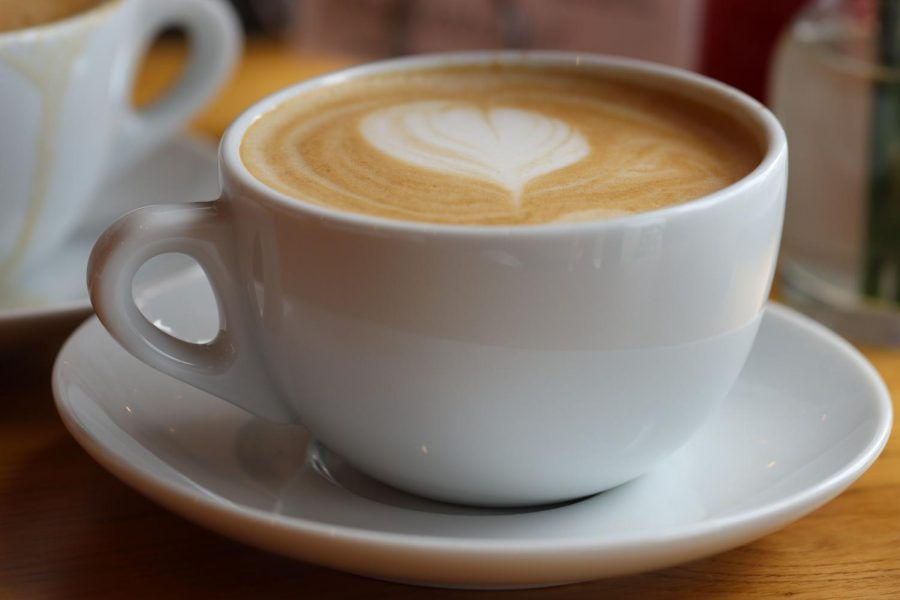 Cup with latte and heart shaped foam