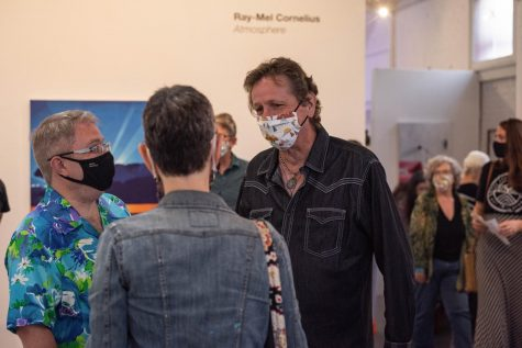Photo of artist Ray-Mel Cornelius speaking to guests